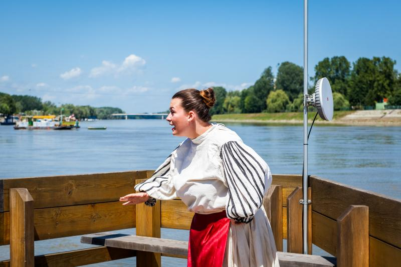 Actress rehearsing, wearing traditional folk costume, location City of Osijek,